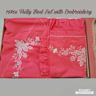 1970s Rosy-Peach Colour Bed Set with Pretty Embroidery & Frilly Pillow/Bolster Cases. Good Condition, probably used once/twice, washed before (best to wash before use). Still has Box. Bedsheet+2 Pillow+1 Bolster for $48. Sms 96337309 for fast deal.