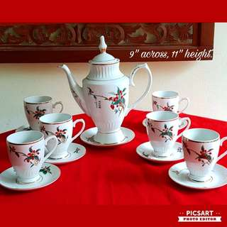 "Lovely Chinese Porcelain Teaset with red & green flowers, elegant with tall footed design. Teapot is 11"" height. Comes with Teapot + 6 cups + 7 saucers (1pc for teapot). Unused, Mint Condition. $35, Sms 96337309 for fast deal."