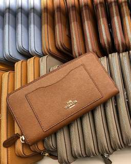COACH ACCORDION ZIP WALLET IN CROSSGRAIN LEATHER IN SADDLE