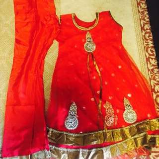 Red sleeveless Punjabi suit