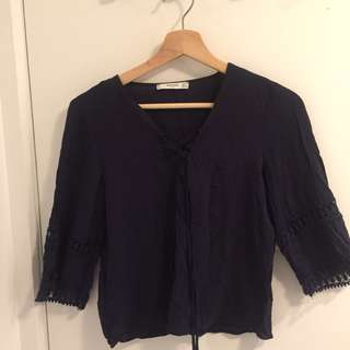 Black criss cross chest blouse