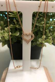 18k rose gold necklace. Heart pendant with real diamonds.