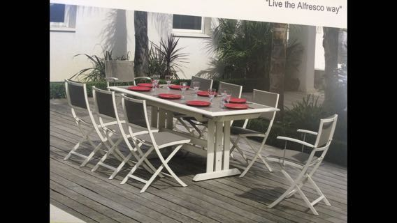 Brand New HEGOA table set with six LES JARDIN chair