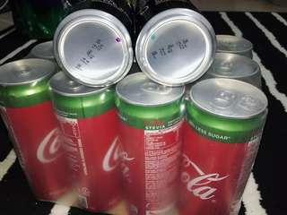 12 tin Coca Cola 330ml + 2 tin Apple juice (free gift)