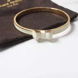 Kate Spade White and Gold Bangle With Bow