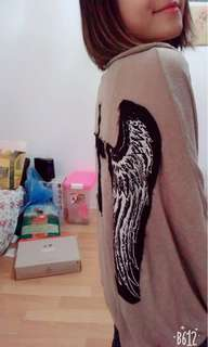 Brown outerwear with black wings pattern