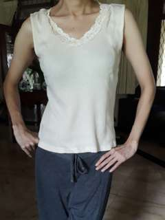 Broken white top with lace neck
