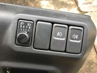 2006, 2007, 2008 Subaru Impreza sedan Fog lamp and headlamp angle adjustment switches
