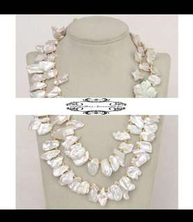 Genuine Lustrous White Freshwater Irregular Baroque Pearls Necklace with a Mother of Pearl seashell Flower clasp. 金屬光亮純白巴洛克不規則真淡水珍珠花朵貝母項鍊