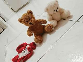 2 teddy bears with a shirt provided