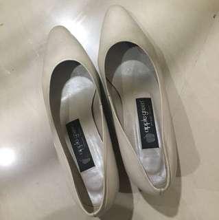Broken white heels