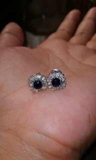 Real Baguettes Diamond and blue sapphire with titus in 14k white gold
