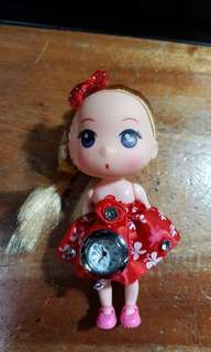 Doll with clock.