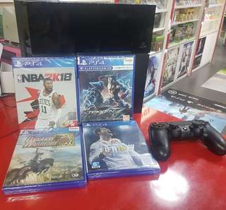 Pre own playstation 4 with one free game