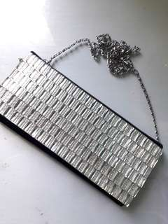 Convertible clutch/sling silver bag