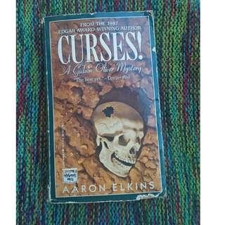 Curses by Aaron Elkins