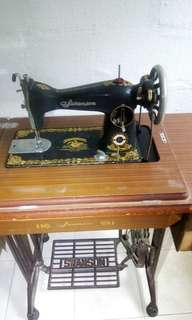 Antique  sewing machine ( over 45 years , some adjustment  may still work