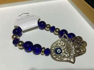Hamsa hand bracelet in blue