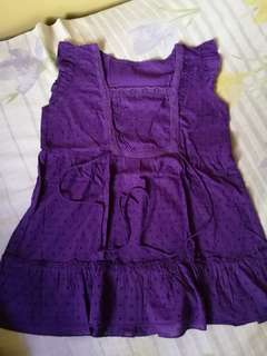violet sleeveless shirt