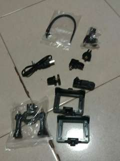 Go pro with charger,strap and other accessories (two carmera.    (Gold and bule ) )
