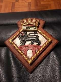 Cast iron crest mounted on customized hardwood