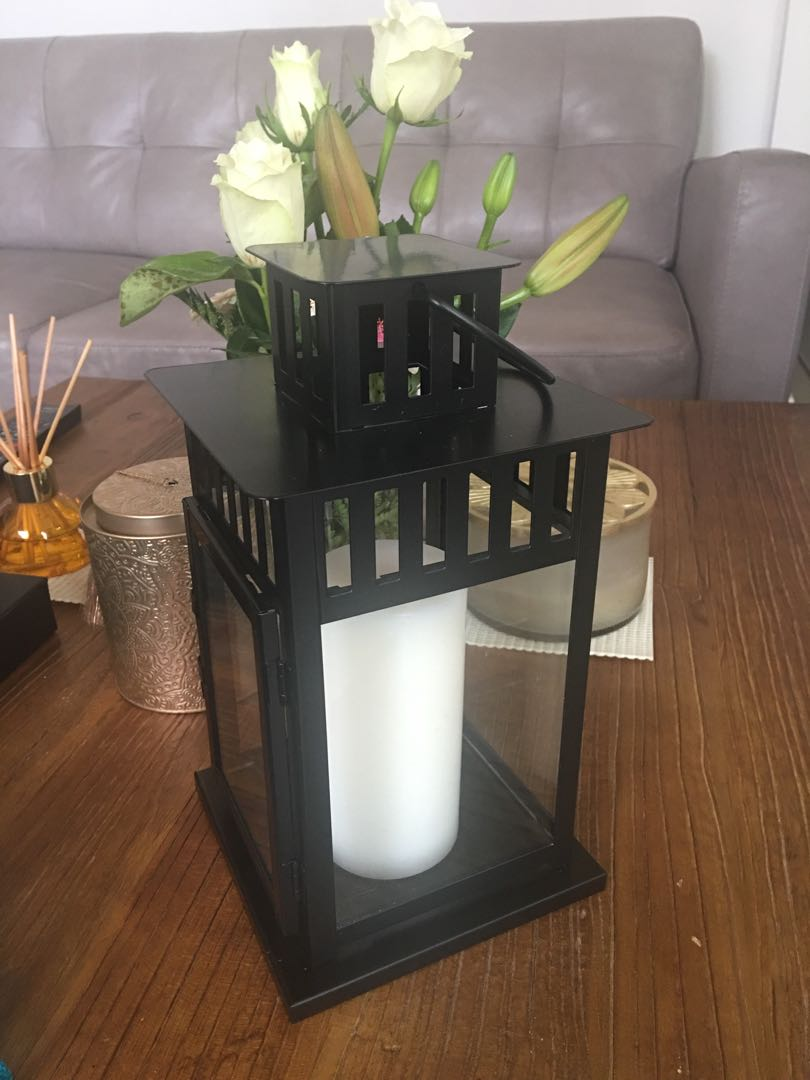 2 black lanterns with scented candles inside