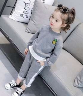 Boys and girls sports sweater + white pull pants