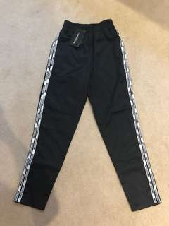 Pretty little thing track pants size US 4
