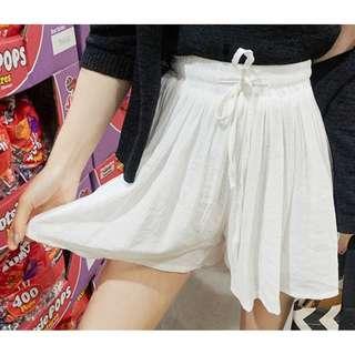 夏季清爽百搭綁帶設計飄逸褲裙 skirt ( CHUU 官網代購 ) 鬆緊帶 短褲 短裙 素色 修身 顯瘦