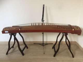 Guzheng (with the music stand) .
