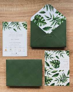 Tropical leaves with gold foil wedding invitation