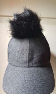 Pom pom cap in dark grey