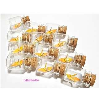 #CIB12s8. Lot of 12pcs Goldenrod Color 1-inch Hand-folded Paper Crane In A Mini Glass Bottle With Cork. (AV paper series).