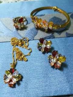 Gold set with gem stones