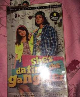 She's dating the gangster book