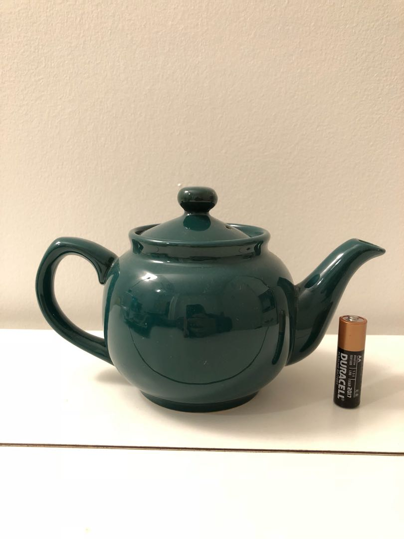 Cute little green teapot