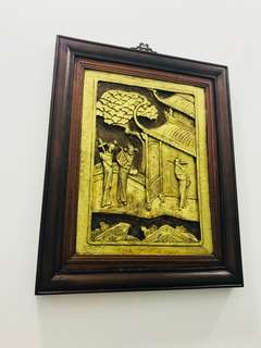Wooden panel with gold leaves