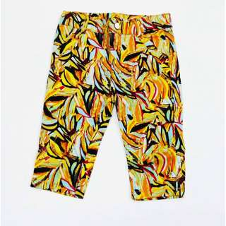 Yellow cotton pants with abstract print