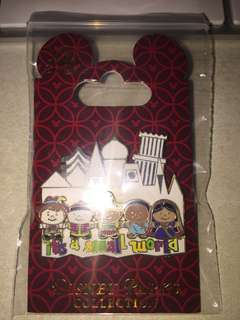 Brand new. Disney Parks collection. It's a small world pin