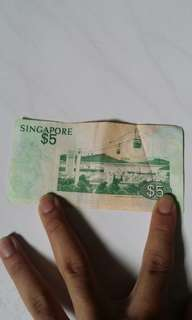 Old Singapore $5 and $1 note currencies
