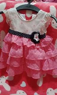 Pink ruffled dress with bule ribboen