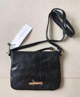 BCBG generation black sling bag