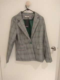 Grey blazer with green accents
