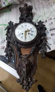 Old bronze wall clock.