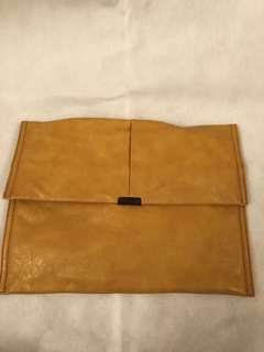 initial earth tone leather clutch