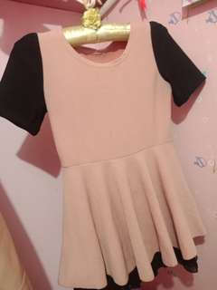 Pastel pink and black A line dress.