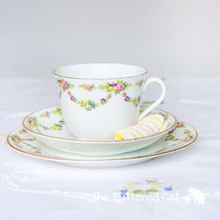 Enchanting vintage English bone china trio, pretty garlands of pansies and roses