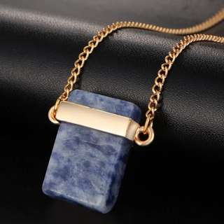Blue stone on gold chain layering necklace