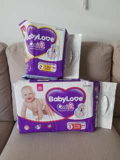 20 Baby Love nappies 4-8kg and 43 Baby Love nappies 6-11kg