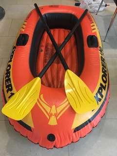 Floating boat with oar